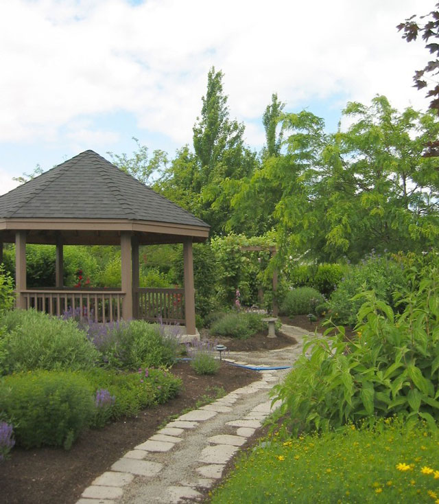 Gazebo and arbor creates a hidden garden space