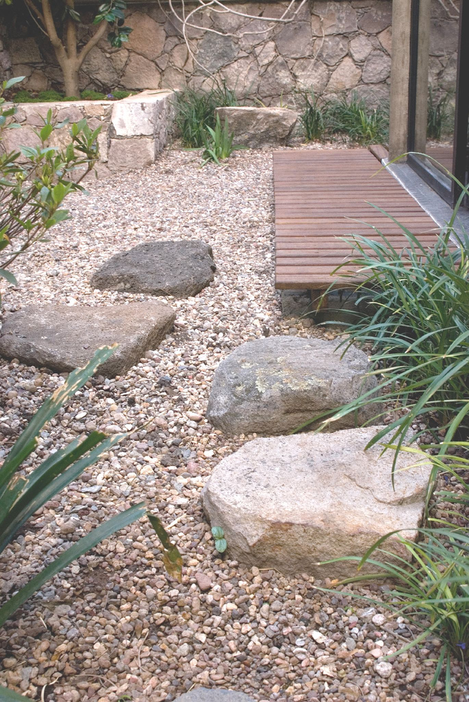 Informal stone for dry garden area in backyard Japanese garden