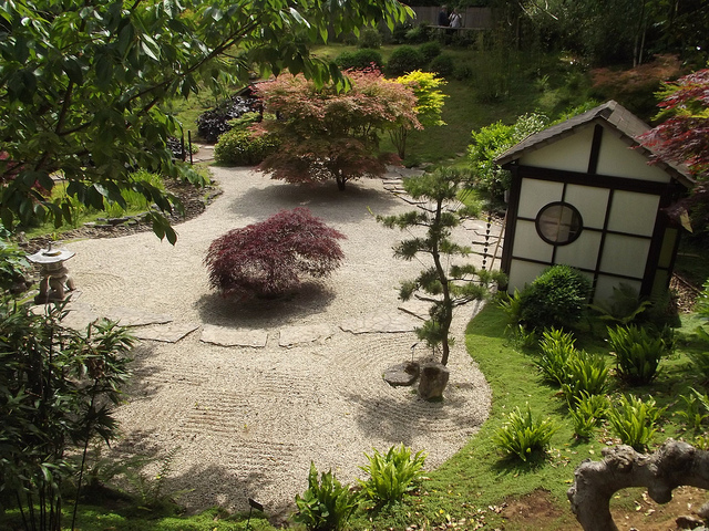 Backyard Japanese garden with stepping stones winding through dry garden