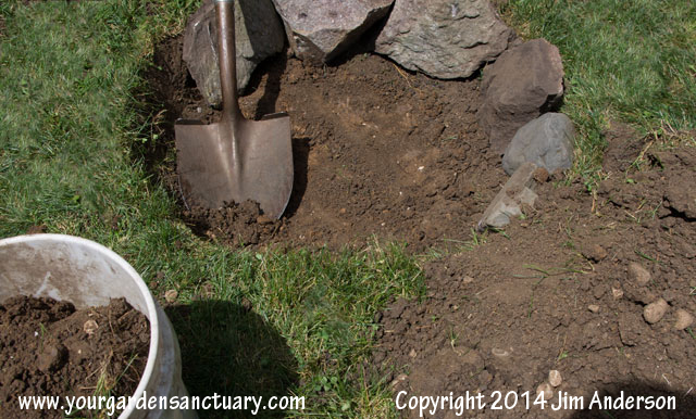 Cheap easy fire pit from some stones and a shovel